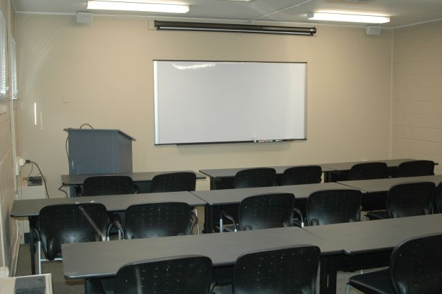 Classroom environment with a whiteboard at the front of the classroom